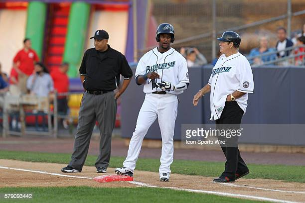 Pete Rose chats with Bridgeport Bluefish outfielder Denny Almonte after a base hit during a minor league baseball game in which Pete Rose, the...