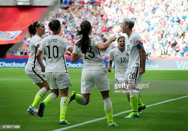 United States forward Abby Wambach is congratulated by teammates on a late first half goal that propelled the team past Nigeria on Tuesday at BC...
