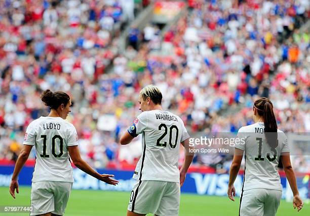 United States forward Abby Wambach walks off the field with midfielder Carli Lloyd and forward Alex Morgan after a late first half goal that...