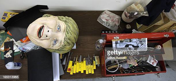 June 17, 2010 German Chancellor Angela Merkel awaits repair as Ted Heeley is the sculptor who is fixing the G20 heads and rushing to modify the head...