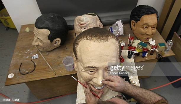 June 17, 2010 Italian PM Silvio Berlusconi has a few nicks and scrapes cleaned up by Ted Heeley. Heeley is the sculptor who is fixing the G20 heads...