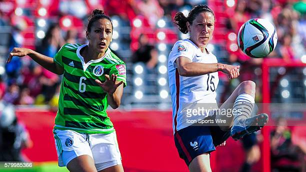 Elise Bussaglia of France gets to the ball ahead of Jennifer Ruiz of Mexico during the FIFA 2015 Women's World Cup Group F match between Mexico and...