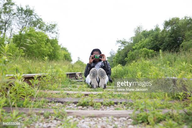 TORONTO ON June 17 2017 Lolley Jeng takes photos on a Scarborough railway track as part of My Toronto an initiative that engages people who...