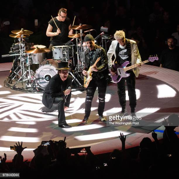 WASHINGTON DC June 17th 2018 Bono Adam Clayton The Edge and Larry Mullen Jr of U2 perform at the Capital One Arena in Washington DC as part of the...