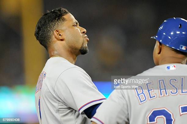 Texas Rangers Shortstop Elvis Andrus [6293] reacts to the safe call reversal at third base after a replay review during the game between the Rangers...