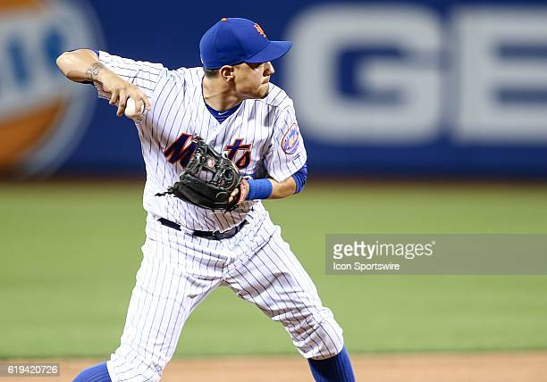 New York Mets Infielder Wilmer Flores [5870] throws out Atlanta Braves Infielder Brandon Snyder [5641] on a ground ball during the ninth inning of...