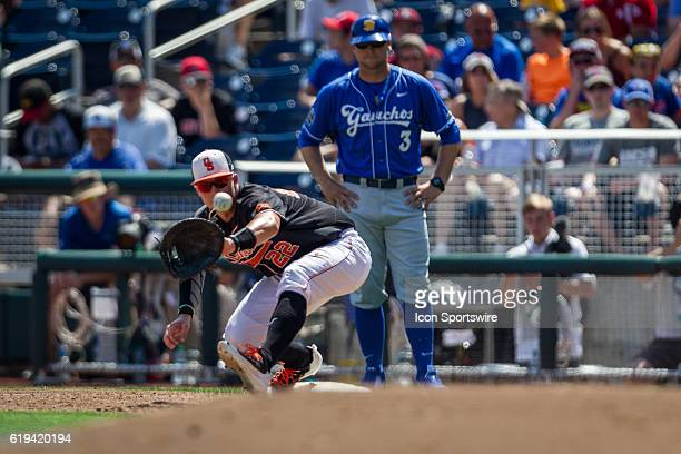 Oklahoma State infielder Dustin Williams makes an out against UC Santa Barbara during the first game of the College World Series in Omaha Nebraska