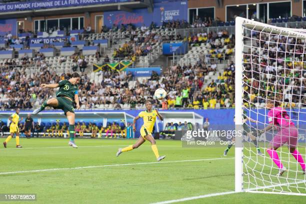 June 18 Sam Kerr of Australia scores her sect goal of the match heading past goalkeeper Nicole McClure of Jamaica during the Jamaica V Australia...