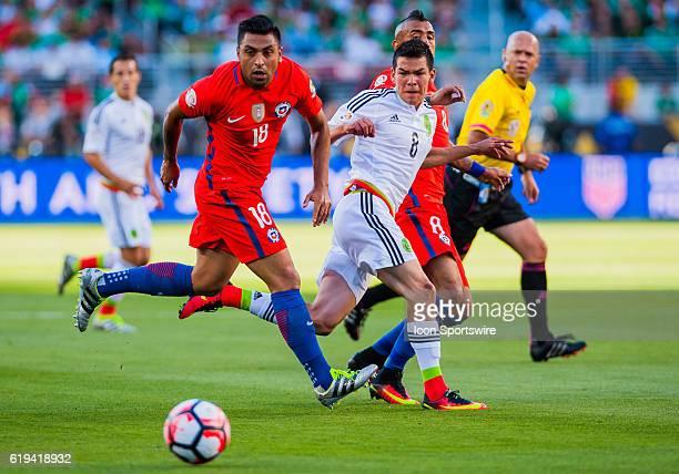 Chile Defender Gonzalo Jara guards Mexico midfielder Hirving Lozano during the Copa America Centerario Quarterfinal match between Mexico versus Chile...