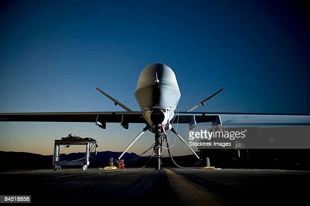 June 19, 2008 - General Atomics Aeronautical Systems contractors refuel a MQ-9 Reaper at Creech Air Force Base, Nevada.
