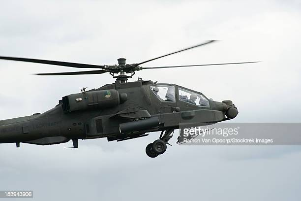 june 19, 2010 - a boeing ah-64d apache helicopter of the royal netherlands air force in flight over volkel, the netherlands. - apache helicopter stock pictures, royalty-free photos & images