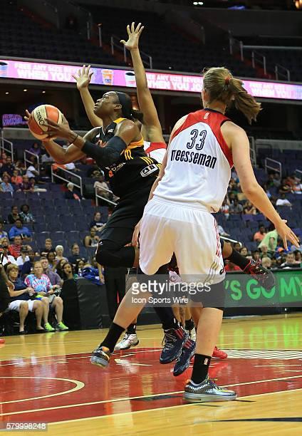 Karima Christmas of the Tulsa Shock shoots as Emma Meesseman of the Washington Mystics watches during a WNBA game at Verizon Center in Washington DC...