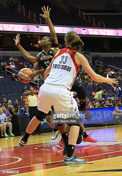 Karima Christmas of the Tulsa Shock shoots past Emma Meesseman of the Washington Mystics during a WNBA game at Verizon Center in Washington DC Tulsa...