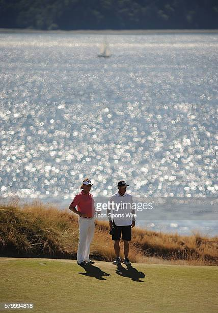 June 19 2015 Miguel Angel Jimenez and his caddie stand on the 15th green with Puget Sound in the background during second round play at the 115th US...