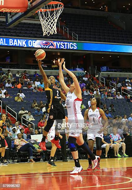 Riquna Williams of the Tulsa Shock shoots over Stefanie Dolson of the Washington Mystics during a WNBA game at Verizon Center in Washington DC Tulsa...