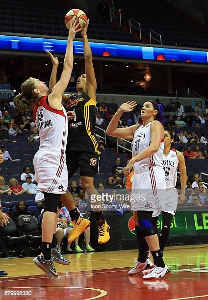 Skylar Diggins of the Tulsa Shock shoots over Emma Meesseman of the Washington Mystics during a WNBA game at Verizon Center in Washington DC Tulsa...