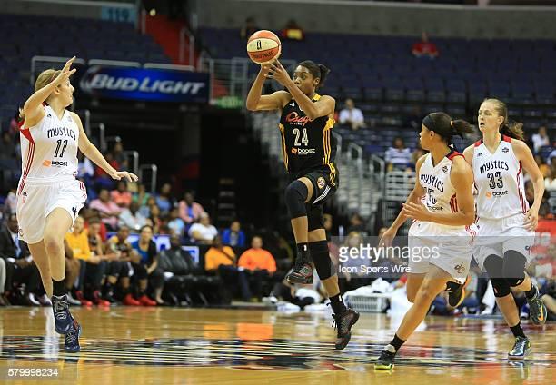 Vicki Baugh of the Tulsa Shock shoots as Ally Malott of the Washington Mystics moves to defend during a WNBA game at Verizon Center in Washington DC...