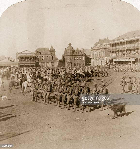 Troops marching in formation past Lord Roberts of Kandahar and Waterford FieldMarshal and commander of the British forces in the Boer War after the...