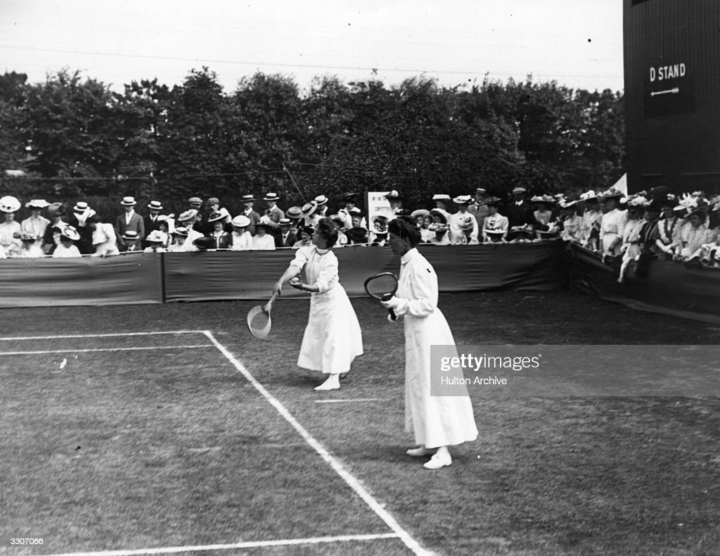 May Sutton of the USA and Blanche Hillyard (nee Bingley) of Britain competing in a women's doubles match at Wimbledon.