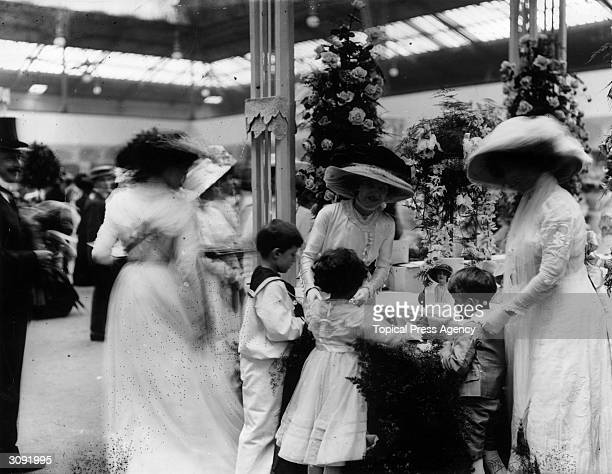 A stall at a Midsummer Fete at Olympia in aid of Great Ormond Street Children's Hospital being run by actress Miss Lily Elsie