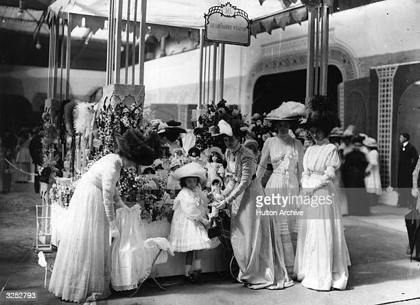 Lady Beatrix Wilson and her daughter running stall 16 at a midsummer fete in aid of Great Ormond Street Children's Hospital held at Olympia London