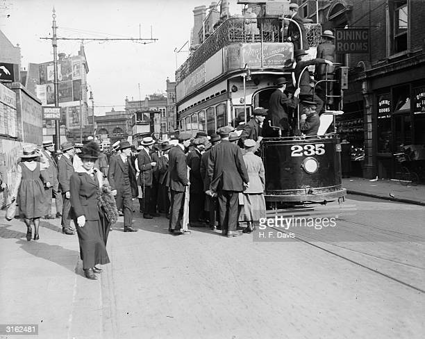 Bank Holiday crowds boarding a tram
