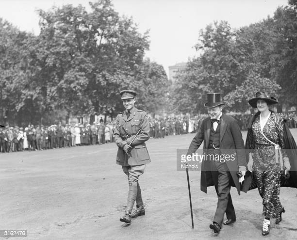 Winston and Clementine Churchill with Lieutenant Bruce Ashcroft attend an inspection of the Royal Naval Division of the Horse Guards