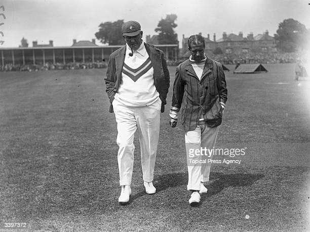 Australian captain Warwick Armstrong and England captain John W H T Douglas walking across a cricket pitch