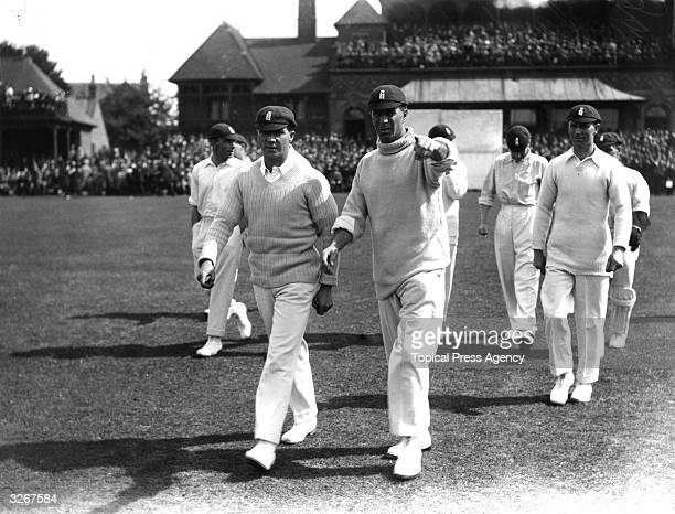 Cricketer John William Henry Tyler Douglas leading his team onto the pitch for the Test match between England and Australia