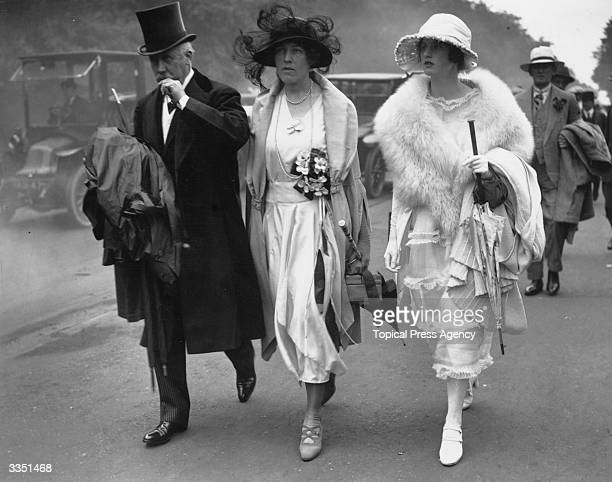 Visitors to Ascot race course Berkshire dressed in their best