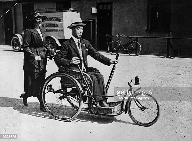 A blind and disabled man steering an invalid carriage
