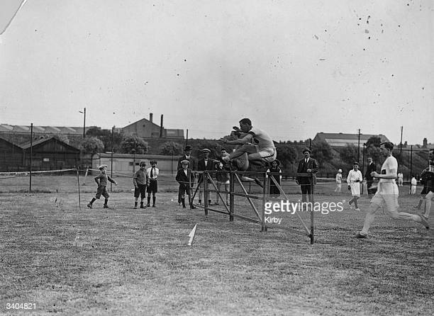 A hurdle race in progress during the Midland Railway Sports Day at Cricklewood