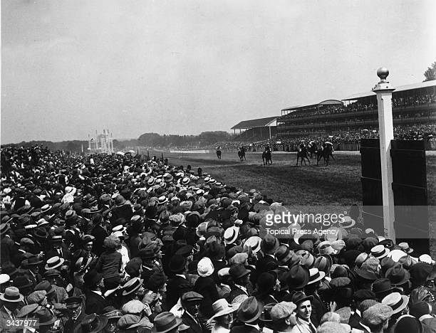 Crowds watching the racing at Ascot.