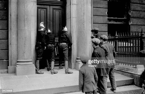 Firemen at Fowler Hall part of the Irish Law Courts in Dublin where the antitreaty section of the IRA have established their headquarters during the...