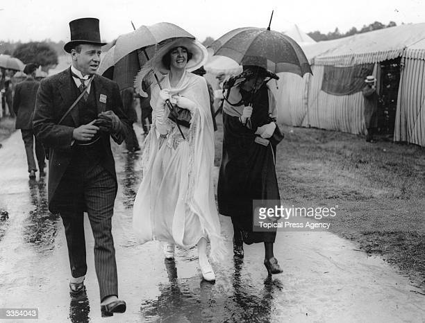 First day fashions at Ascot get caught in the rain.
