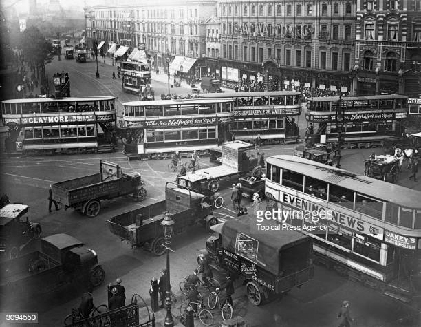 LCC trams of classes B A and E/1 K type buses and subsidy lorries causing a small traffic jam at the Elephant and Castle LondonThe trams are...