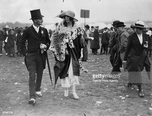 Major and Mrs Hedges stride purposefully about in their finery at Ascot