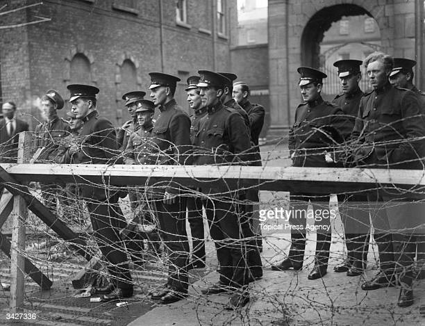 Members of the Black and Tans an armed auxiliary force of the Royal Irish Constabulary and British Army privates watching fighting during the siege...