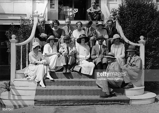 Politician Colonel Cyril Hankey secretary of state for war amidst a party of golfers on the steps of the Golf Hotel at Le Touquet Also in the group...