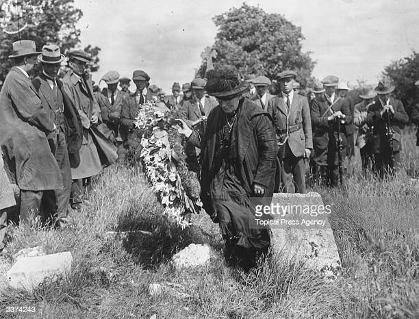 The mother of Irish nationalist Patrick Pearse carries a wreath to lay at her son's grave