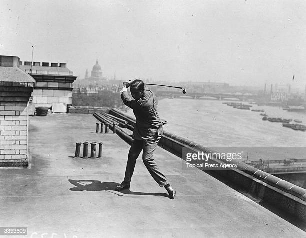 US golfer Walter Hagen winner of the USPGA and Ryder Cup Captain practising on the roof of the Savoy Hotel London by the River Thames
