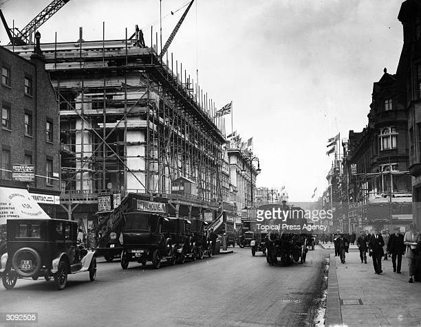 Scaffolding is erected around the new extension to Selfridges the famous London department store in Oxford Street