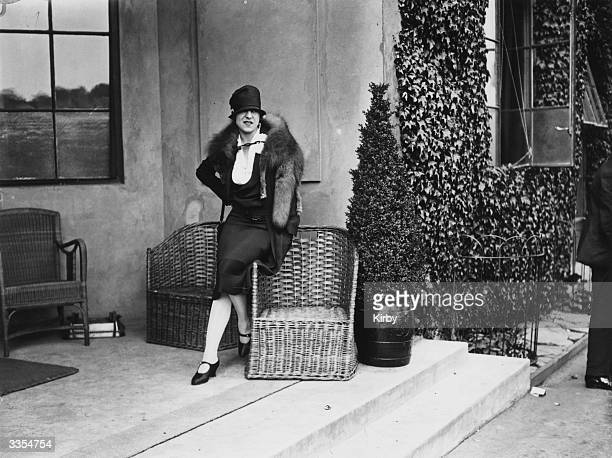 French tennis player Suzanne Lenglen relaxing during the Wimbledon tennis championships.