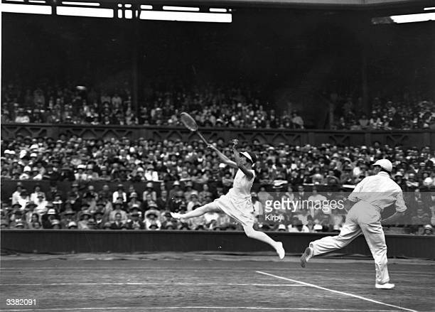 Tennis partners Evelyn Colyer and P D Spence in action during their mixed doubles match against Bela von Kehrling and Lili de Alvarez at the...