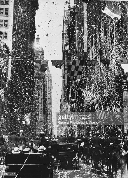 New York City celebrates Charles Lindbergh's return with a ticker-tape parade, after his non-stop one-man transatlantic flight from New York to Paris.