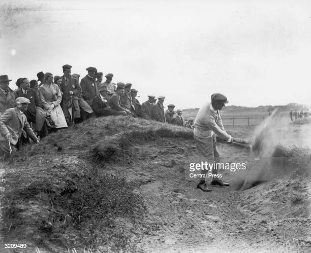 Scottish golfer Thomas Armour drives from the bunker during the British Open Golf Championship at Carnoustie