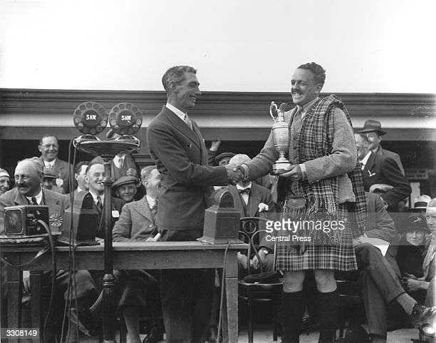 Scottish golfer Tommy Armour is presented with the British Open trophy at Carnoustie This was Armour's final victory in one of the four major...