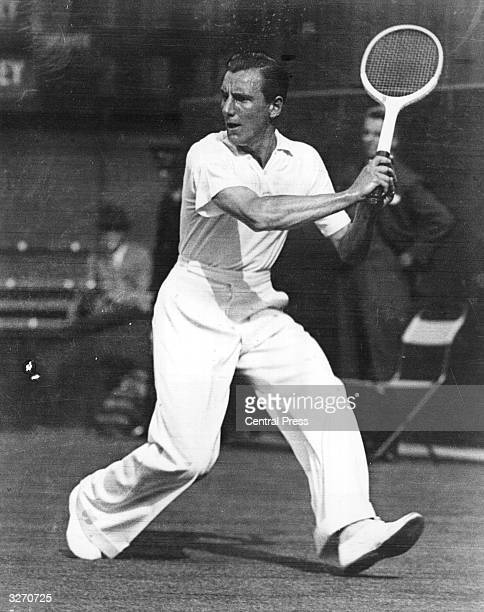 British tennis player Fred Perry swinging for a backhand at Wimbledon.