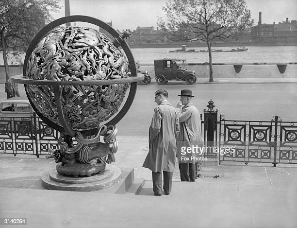 Visitors inspect a celestial globe depicting the constellations Coma Berenices Canes Venatici and Libra at the Tate Gallery in London