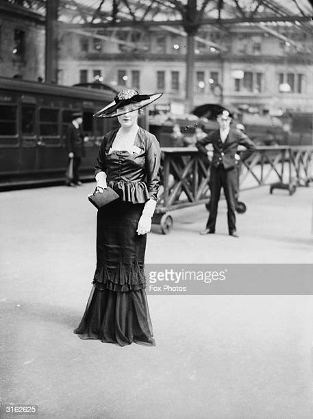 Mrs William Connaught at a railway station on her way to the races at Ascot